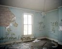 Image of Beechwood: Blue Bedroom with Graffiti and Damaged Wall