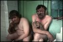 Image of Two Miners Sit in a Shower Room After Their Shift, Novokuznetsk, Russia