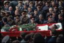 Image of The flower-covered body of a soldier who was killed during the violent conflict at the Russian White House in October 1993 is carried past a group of officers and other mourners at the funeral. Hundred were killed or injured in the conflict Moscow, Russia